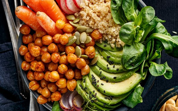 Avocado, Chickpeas, Carrots and lettuce on a plate
